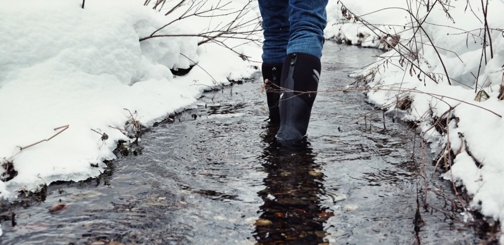 Person Wearing Dryshod Boots standing in stream